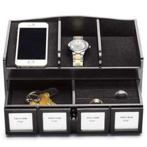 "Men's Phone Valet with Organizer $24.99 Item# 608-201 DESCRIPTION Perfect for keeping your belongings in place at work or at home. Includes four built-in frames for displaying family photos. 10"" L x 6"" W x 4 3/4"" H. Man-made materials. Imported."